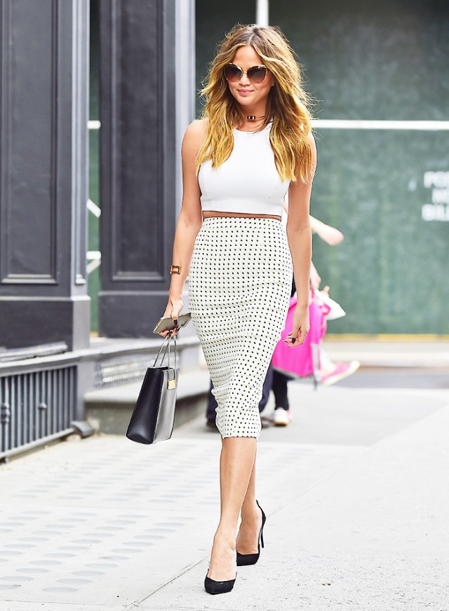 Chrissy Teigen wearing white pencil skirt