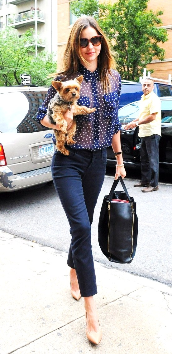 Gorgeous Victoria Secret model Miranda Kerr is seen arriving at a studio with her little dog in hand in New York City
